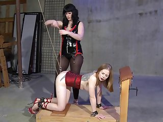 Malignant haired lesbian mistress gives her blonde attendant a rough sex session