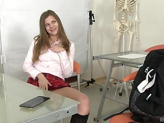 Solo teen model masturbates with toys in a schoolgirl's outfit