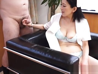 Naughty mature Asian nurse enjoys giving hot handjob at one's fingertips work