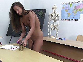 Schoolgirl rubs pussy naked while in a difficulty classroom