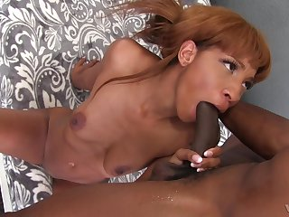 Mature ebony babe September Reign rides a heavy black gumshoe like a nympho