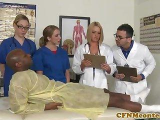 A kinky ebony patient is porking a saucy nurse who luvs to gargle rock firm sausages