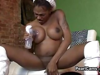 Sexy black transsexual shows off her large breasts and jerks off