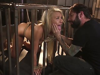Locked in cage gagged hoe Carmen Caliente has to suck delicious boner cock