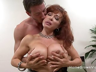 This busty redhead mature was on the prowl for a hot young stud