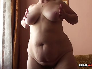 Granny with reference to big titties displays her body