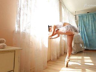 Slender Russian ballerina Nino Belover does the splits and get snaked