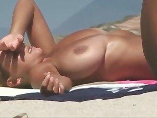 2 busty girls braless on beach
