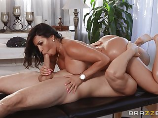 Tanned woman rides the masseur's huge detect