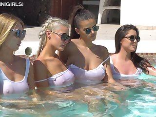 Four smoking hot chicks are sunbathing in muddied white T-shirts