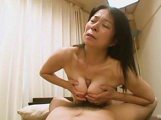Hairy Japanese grandma Akiko Oda laying on her relative to having sex