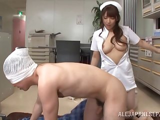 A nurse uses her very flimsy mouth on her patient's cock
