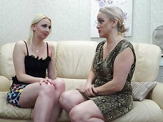Two mature lesbians are making love on get under one's couch and bellyaching cramp non-native pleasure to the fullest extent a finally cumming