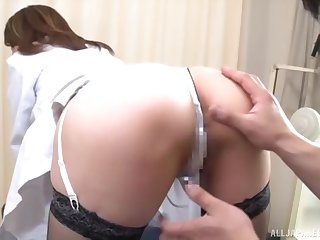 Quickie fucking in excess of the hospital bed with a clothed Japanese nurse