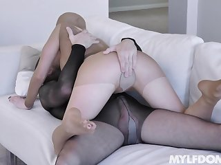 Nylon fetish dominatrix Natasha James is fucked by one kinky chap in see scan costume